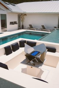 Design your luxury pools area with thoughtfully placed seating areas